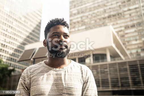 Man looking away in a an avenue