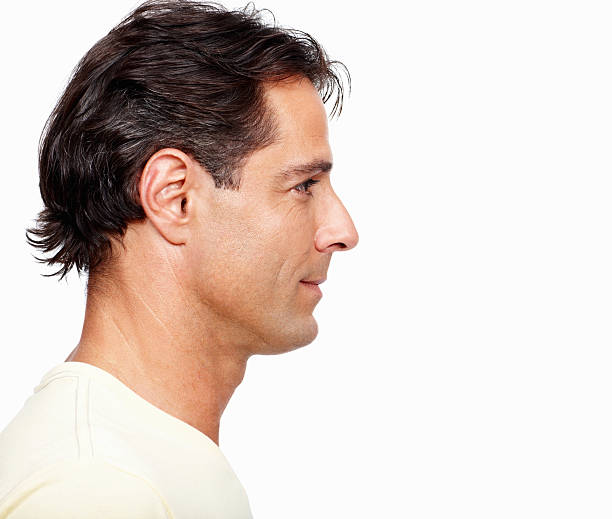 man looking away on white background - profile view stock photos and pictures