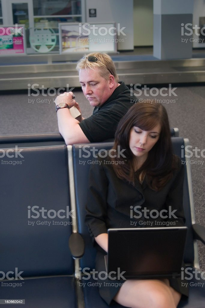 Man looking behind shoulder at woman's laptop screen stock photo