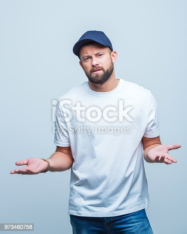 Portrait of caucasian man looking confused on white background