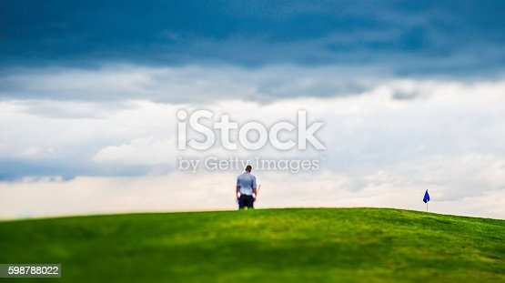 istock Man looking dejected after missing a putt on golf course 598788022