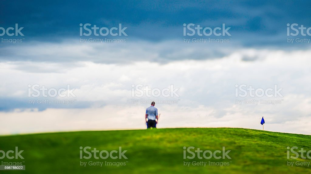 Man looking dejected after missing a putt on golf course stock photo