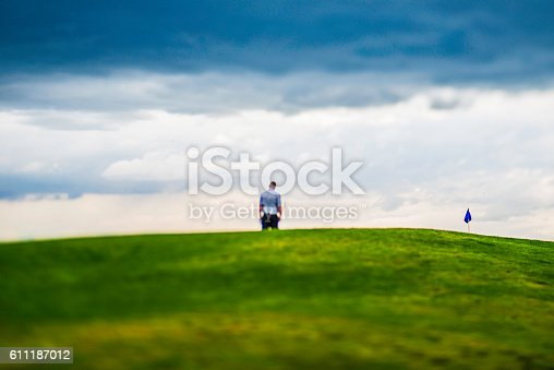 istock Man looking dejected after missing a putt on golf course 611187012