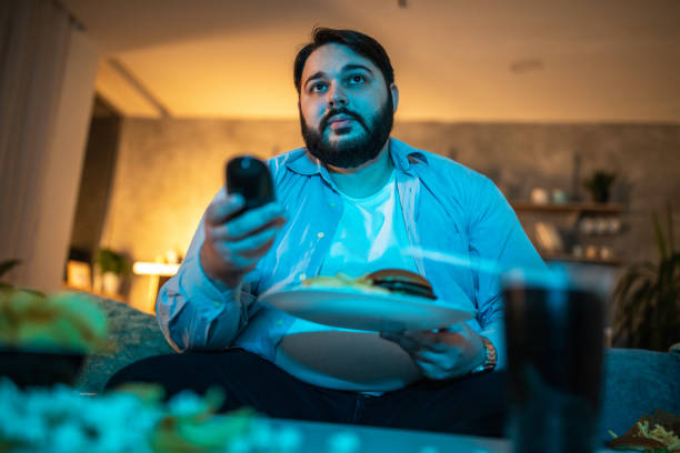 Man looking for something interesting on TV stock photo
