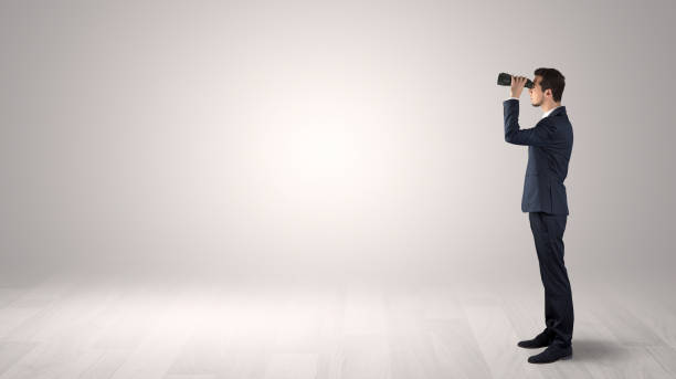 Man looking forward in an empty space concept stock photo