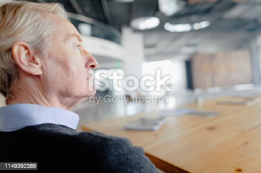 530281733istockphoto Man looking forward in large open lobby space 1149392389