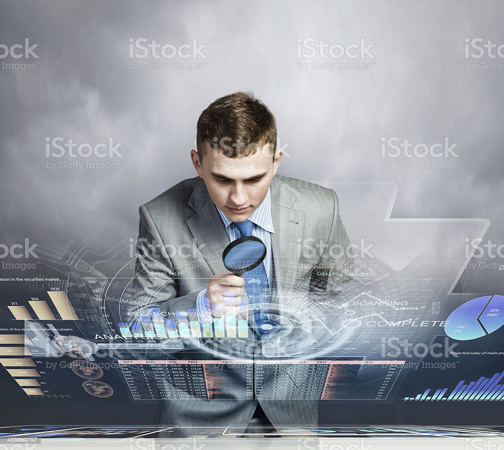 Man looking in magnifier Image of businessman examining objects with magnifier Achievement Stock Photo