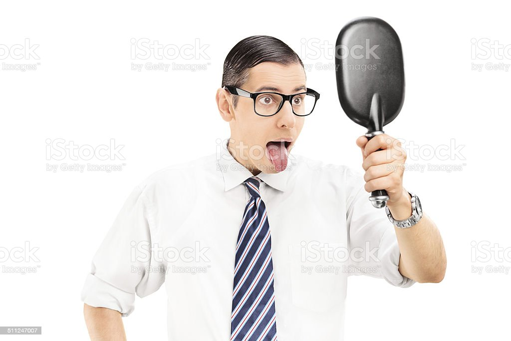 Man Holding Mirror Throughout Man Looking In Mirror And Sticking His Tongue Out Stock Photo Royalty Free Holding Mirror Pictures Images Stock Photos