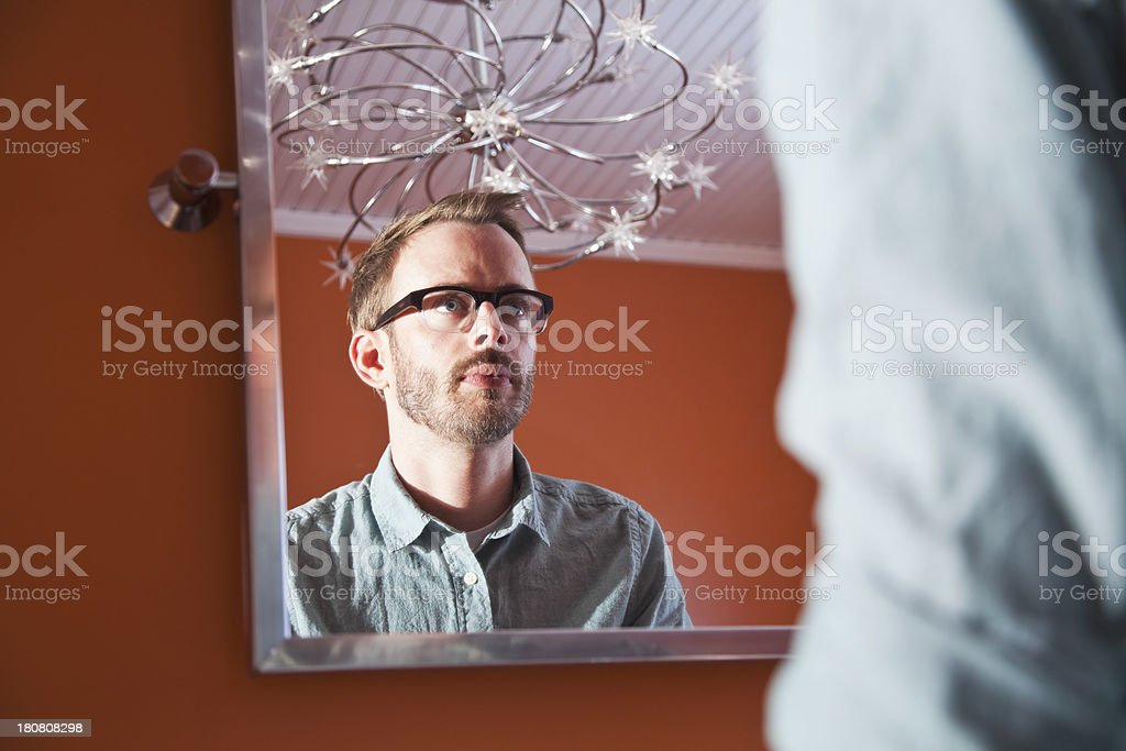 Man looking in mirror royalty-free stock photo