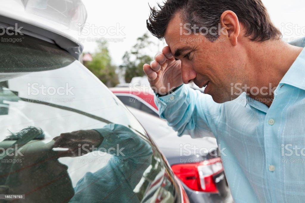 Man looking inside car royalty-free stock photo