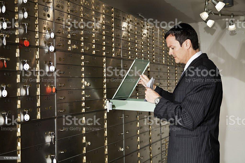 Man looking inside safety deposit box royalty-free stock photo