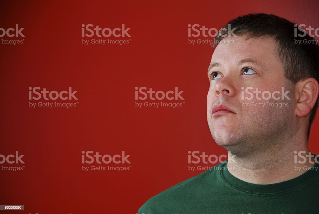 Man Looking into Red with Possible Thought Bubble royalty-free stock photo