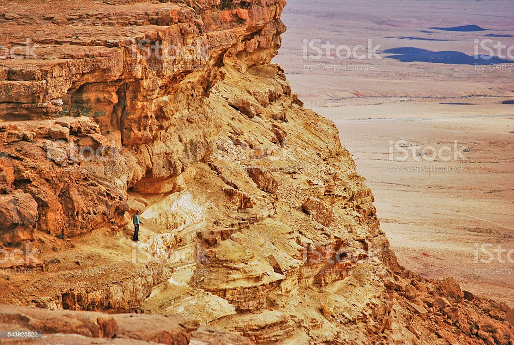 Man looking into the Ramon Crater, Israel stock photo