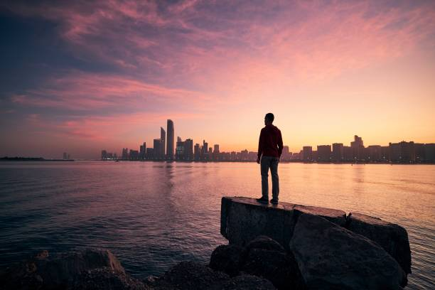 Man looking on cityscape at colorful dawn stock photo