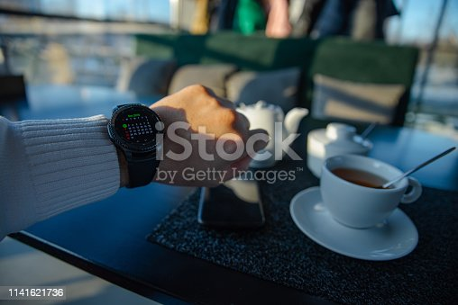 istock man looking on watch sitting in cafe waiting for meeting 1141621736