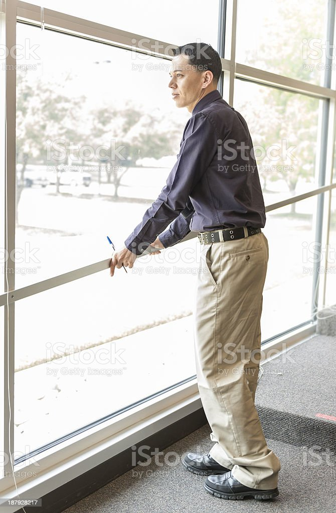 Man looking out a large window royalty-free stock photo