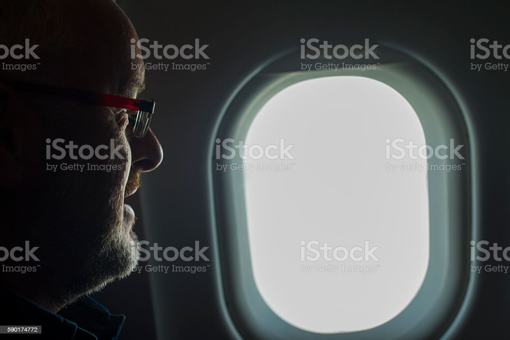 man looking out airplane window royalty-free stock photo