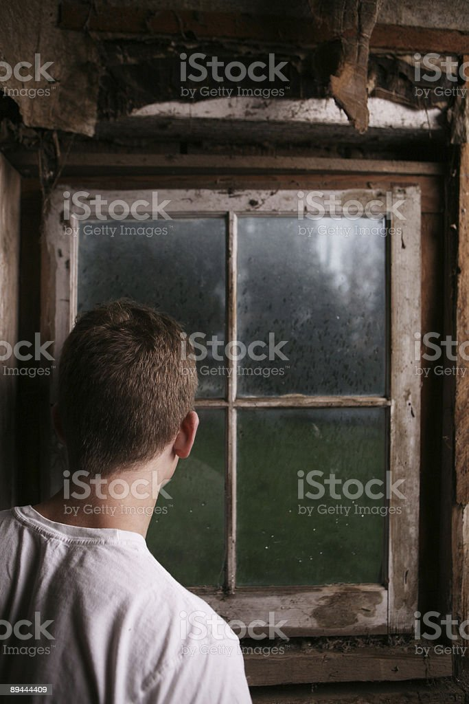 Man Looking Out of Window Portrait royalty-free stock photo