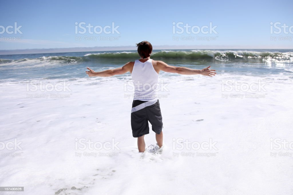 Man looking out to ocean royalty-free stock photo