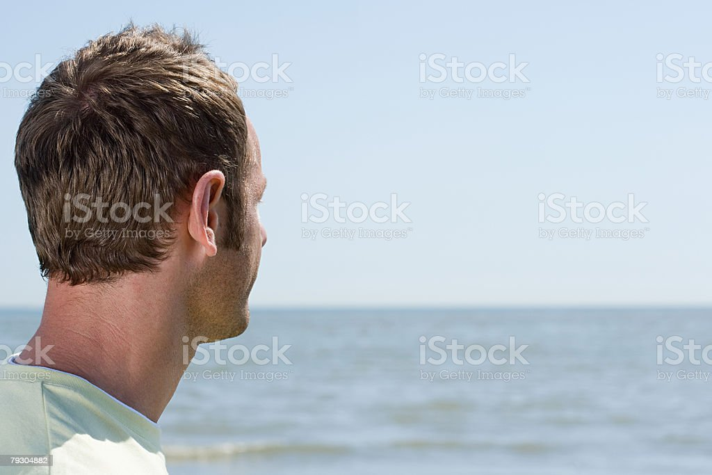 Man looking out to sea 免版稅 stock photo