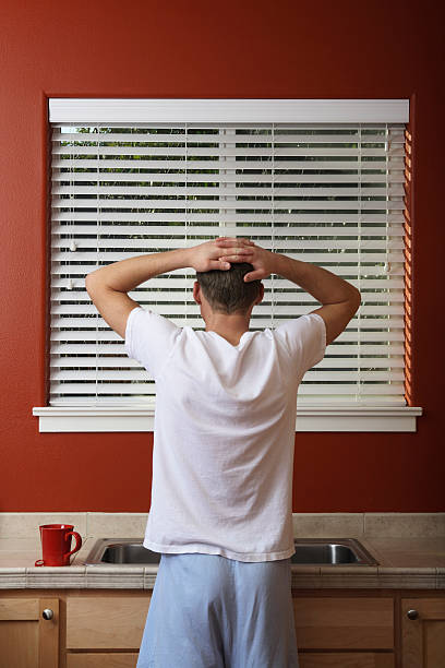 Man Looking Out Window stock photo