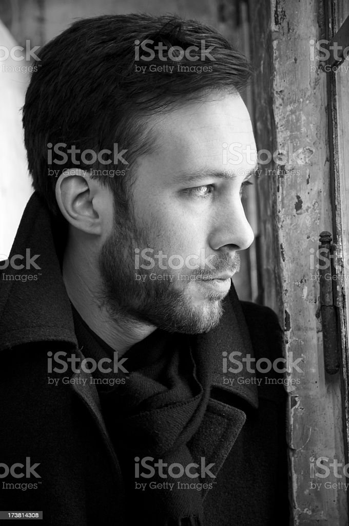 A man looking outside from the window royalty-free stock photo