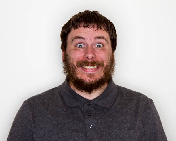 man looking shocked but happy stock photo