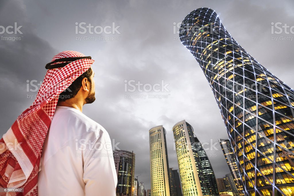 man looking the doha skyline in qatar stock photo