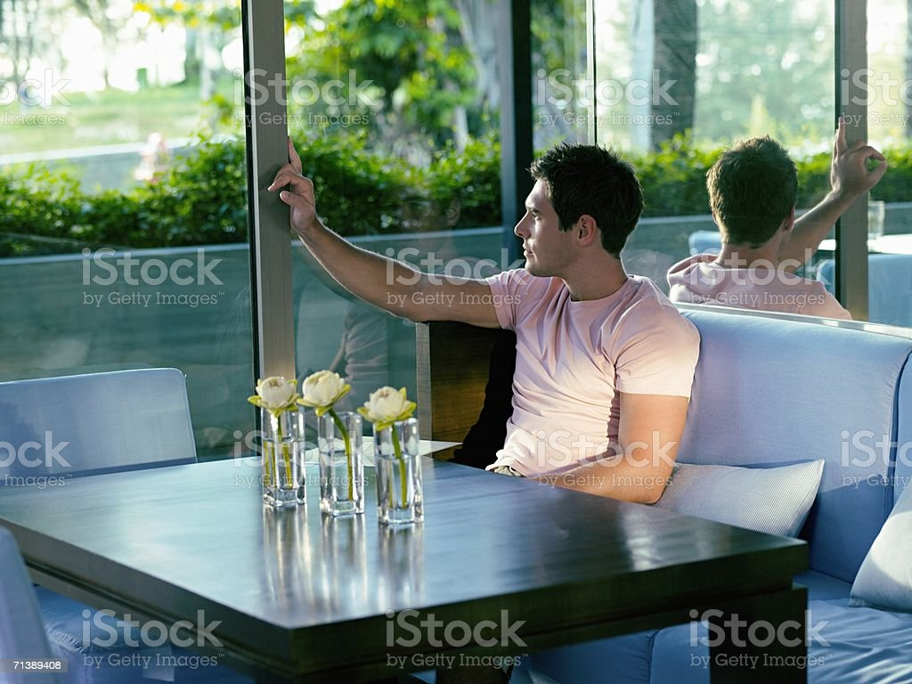 Man looking through a window royalty-free stock photo