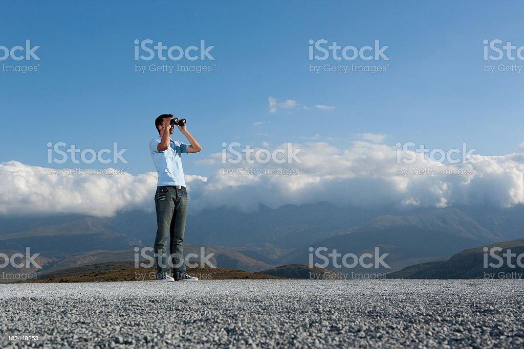 Man looking through binocular at outdoors royalty-free stock photo