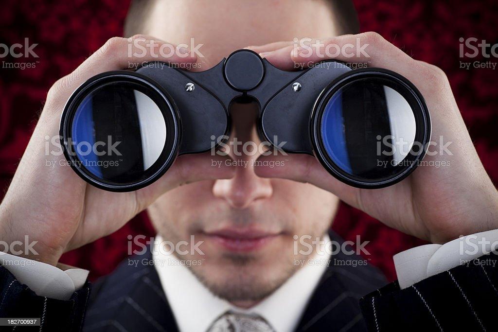 Man looking through binoculars - Royalty-free 20-24 Years Stock Photo