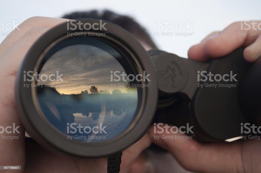 man looking through binoculars a man looking through binoculars Adult Stock Photo