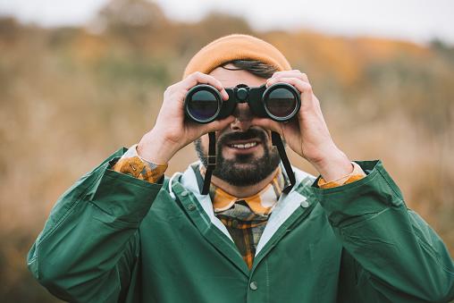Man Looking Through Binoculars Stock Photo - Download Image Now