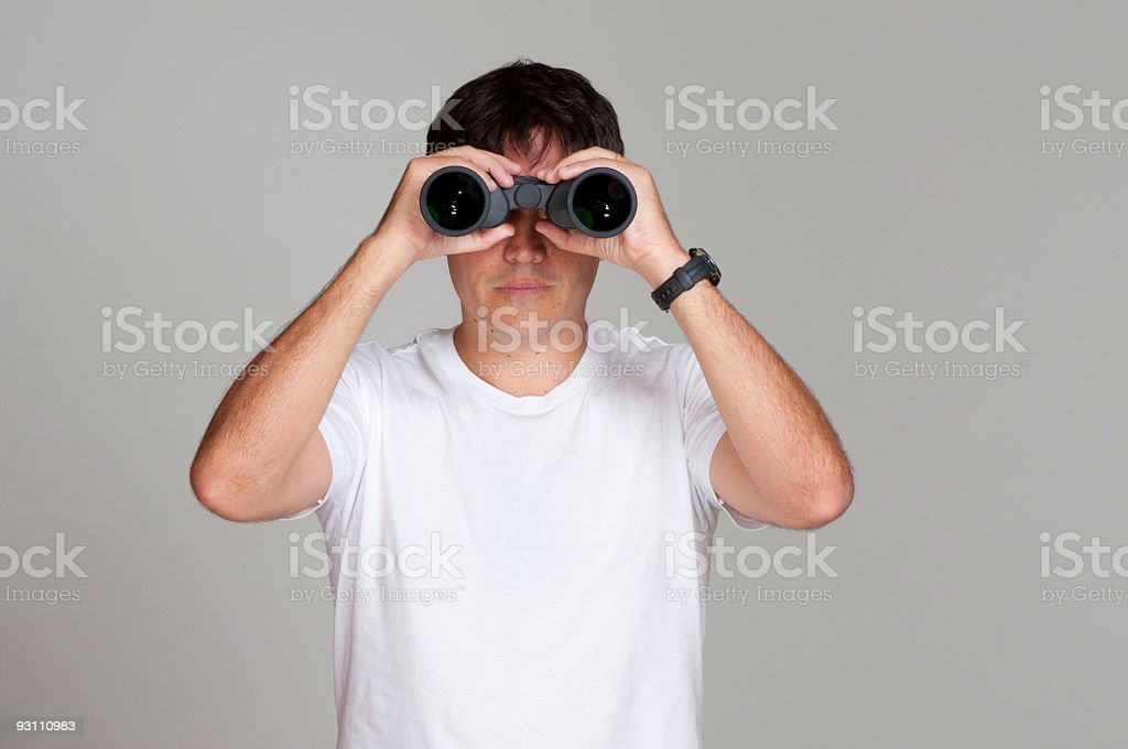 Man looking through binoculars. - Royalty-free Adamlar Stok görsel