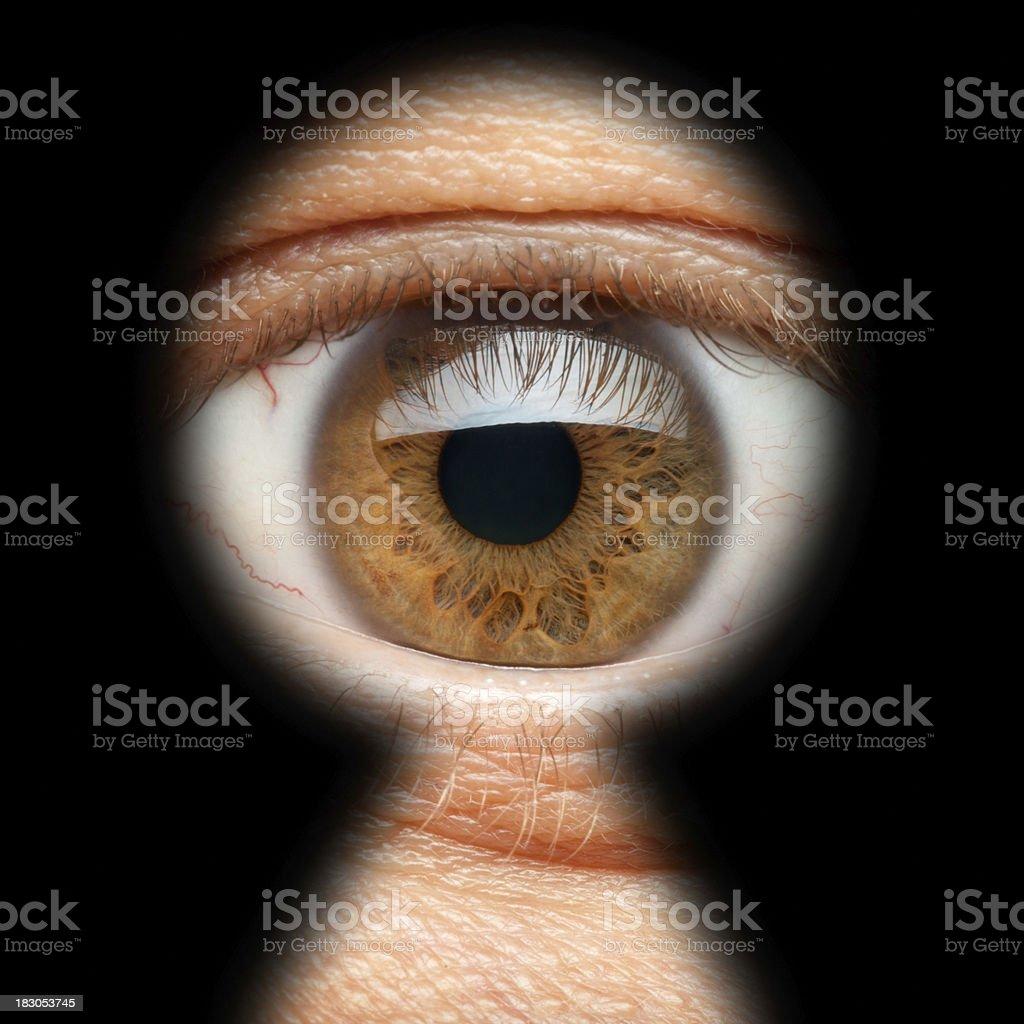 Man looking through keyhole (XXL) royalty-free stock photo