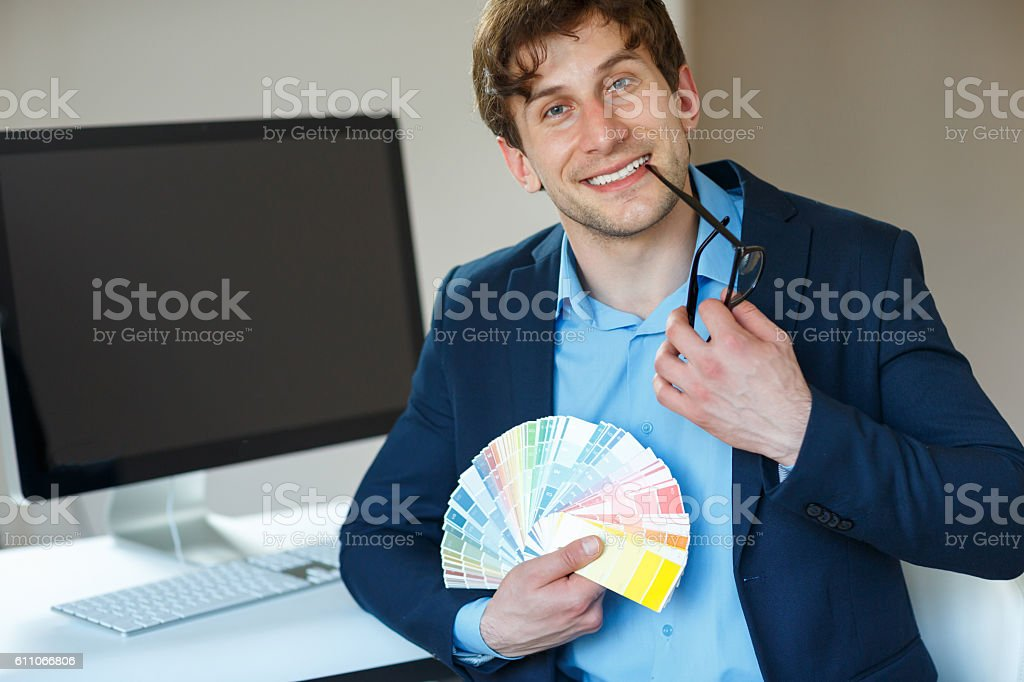 Man Looking To A Color Paint Palette At Home Office Foto De Stock Y