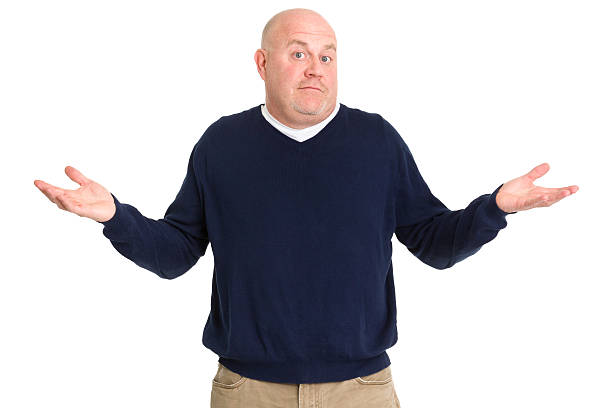 A man looking uncertain and shrugging isolated on white Portrait of a mature man on a white background. shrugging stock pictures, royalty-free photos & images