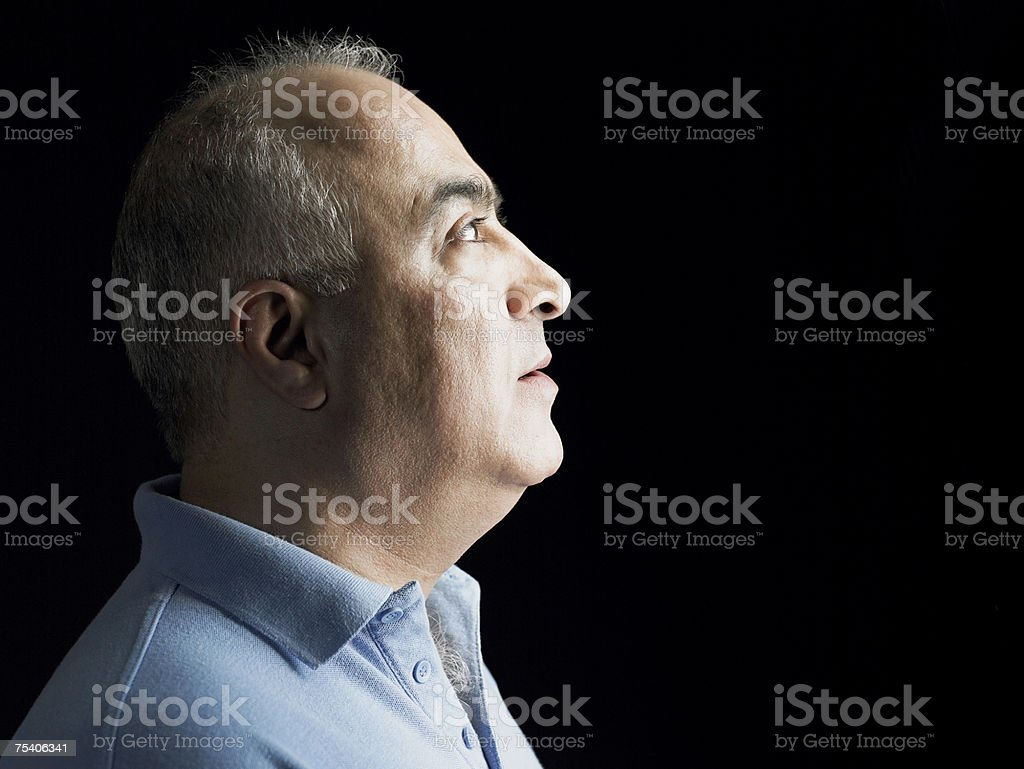 Man looking up stock photo