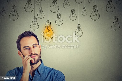 istock man looking up with idea light bulb above head 492221608