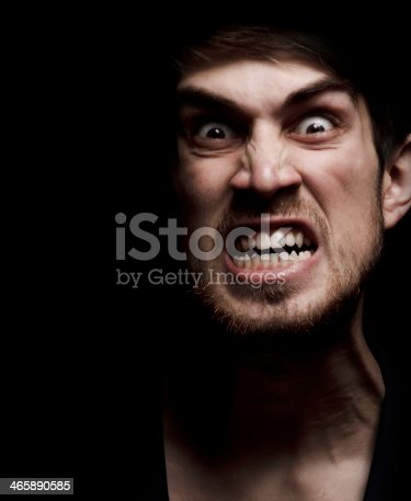 istock Man looking very angry showing his teeth 465890585