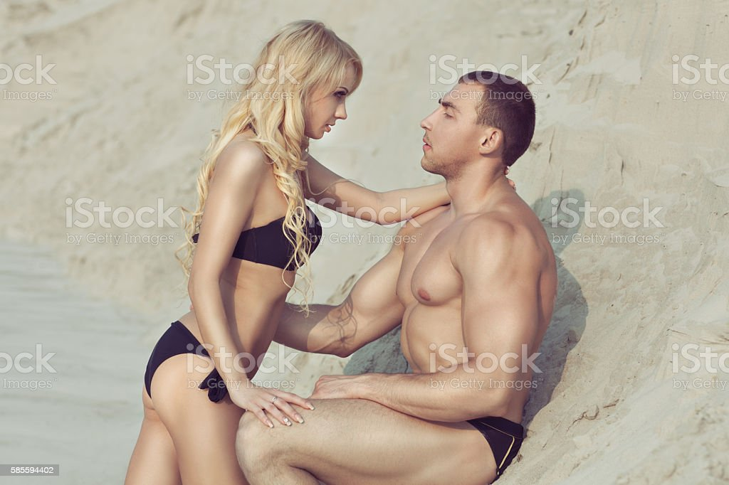 Man looks at a woman. stock photo