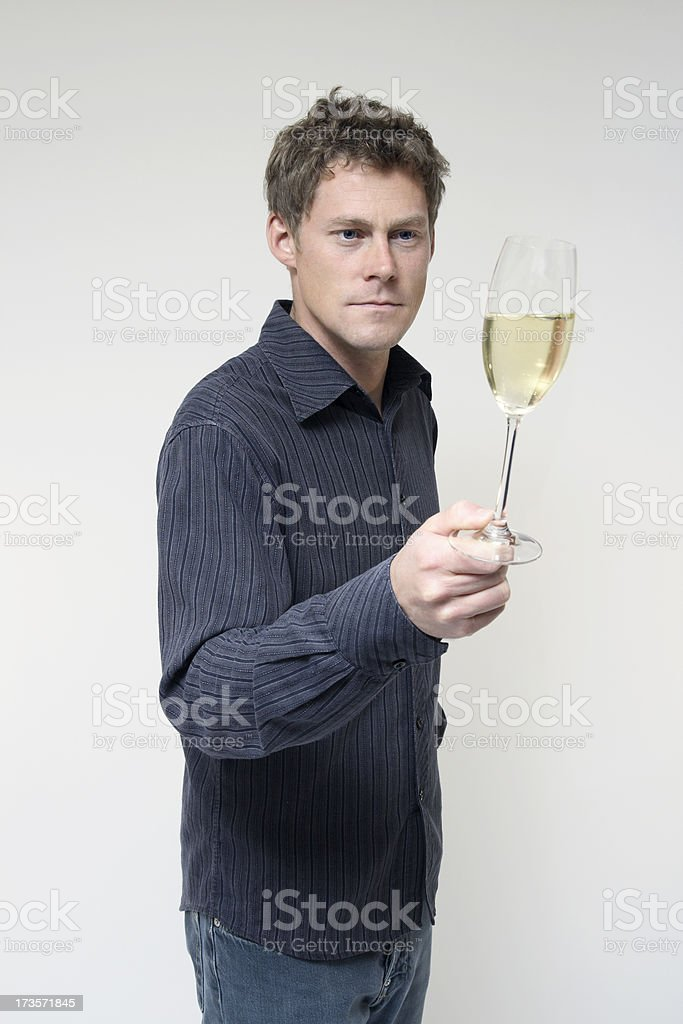 Man Looks at Champagne stock photo