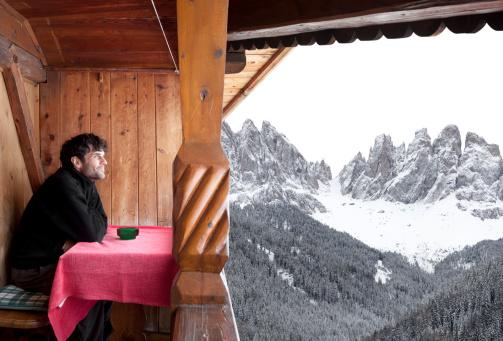 Snowy mountains seen from an alpine hut.