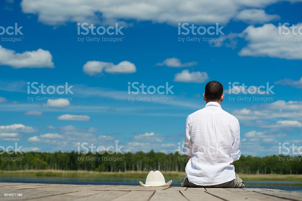man looks at the nature of the pier stock photo