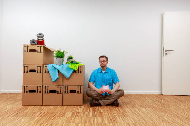 Man looks disappointed at his empty piggy bank in his hands stock photo