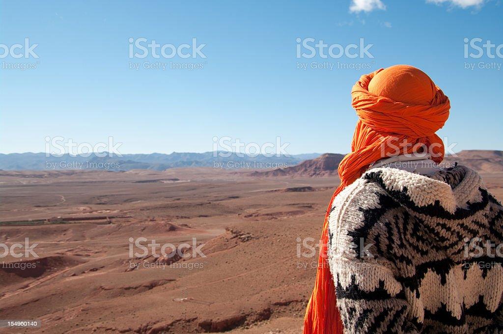 Man looks out at wilderness on edge of Sahara Desert stock photo