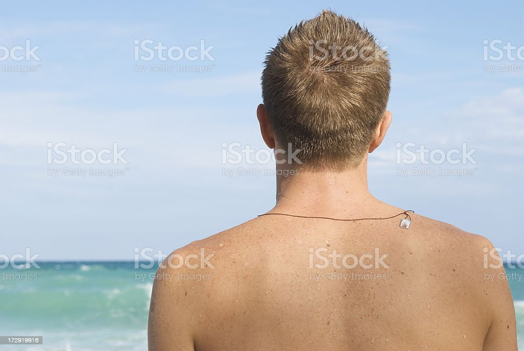Man Looks Out to Tropical Sea stock photo