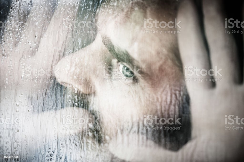 Man looks pressed against the Window, Rain royalty-free stock photo