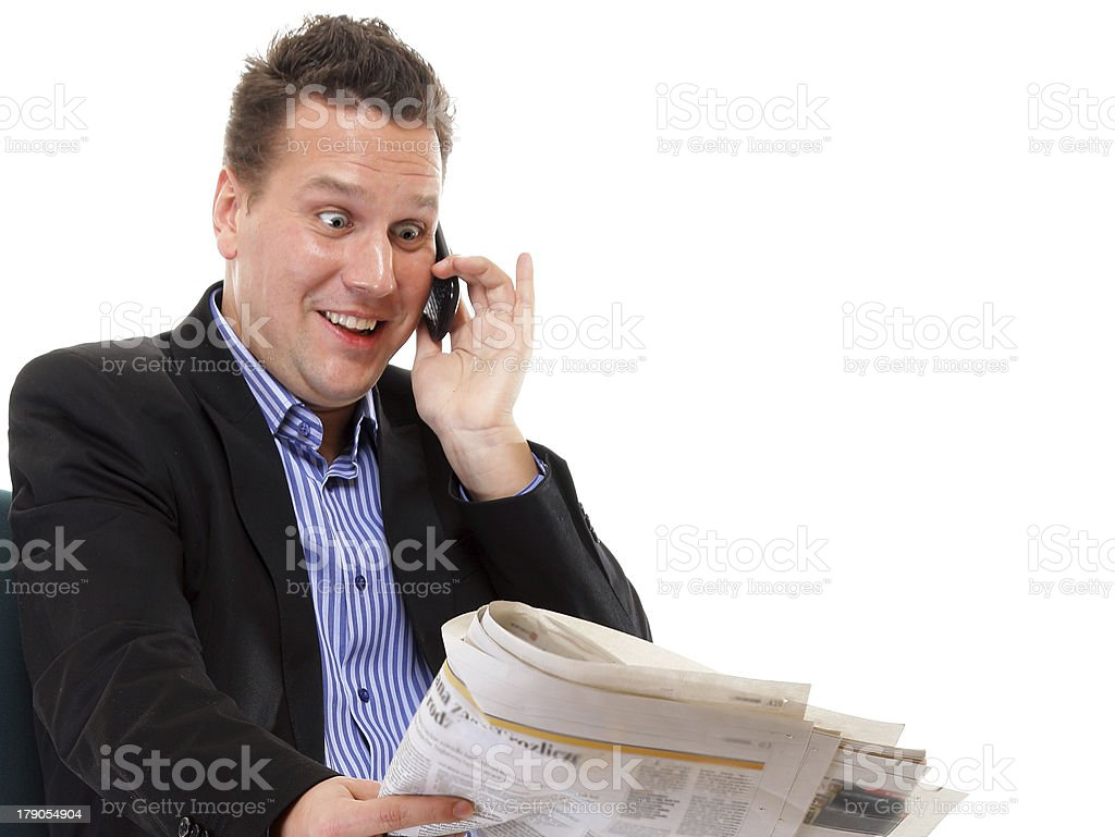 man looks surprised while reading a newspaper royalty-free stock photo