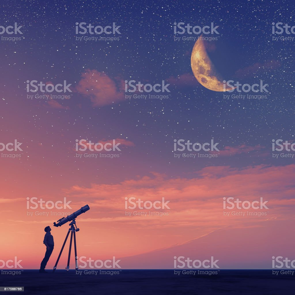 Man looks through a telescope stock photo
